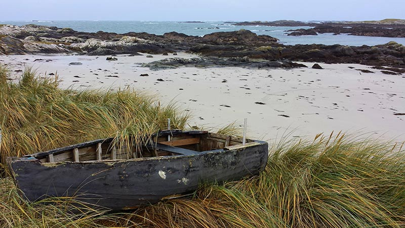 Currach on a beach in Connemara
