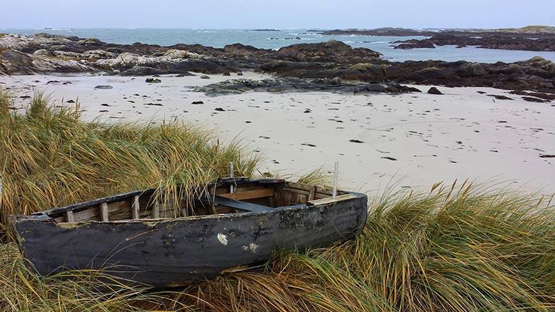 Currach on a beach in Connemara